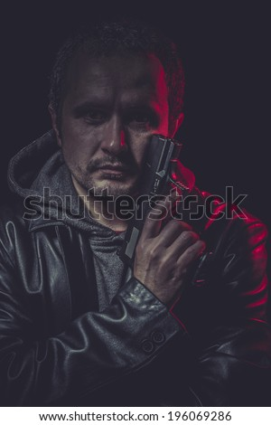 Weapon, secret agent with gun and red light - stock photo