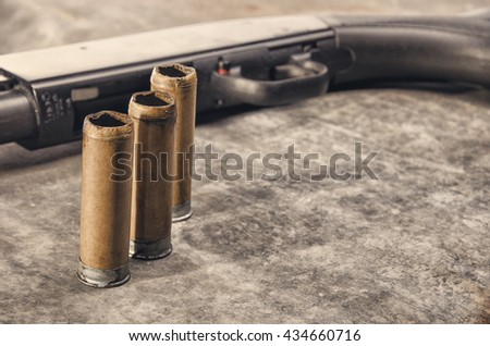 Weapon. Shotgun concept. Black shotgun and shotgun sleeve.  Detail. - stock photo