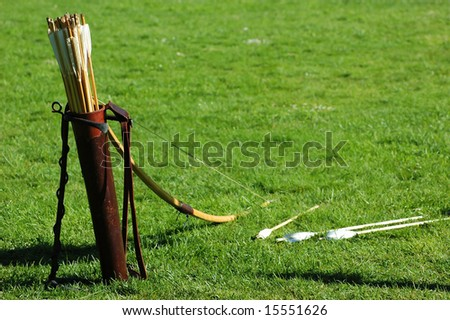 Weapons: arrows and bow - stock photo