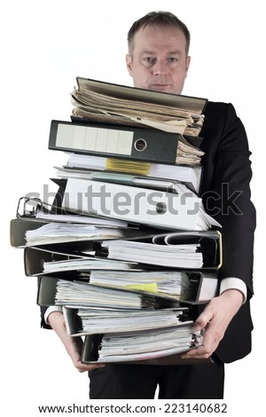 Wear mountain of files - stock photo