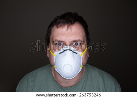 Wearing his mask this man stares out at the camera - stock photo