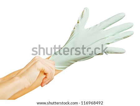 wearing surgical glove - stock photo
