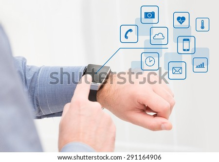 Wearing touchscreen smartwatch with app icons. Abstract smart watch concept. - stock photo