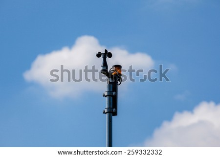 Weathercock against blue sky, closeup shot - stock photo