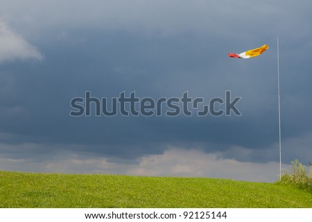 Weathercock indicating the approaching storm - stock photo