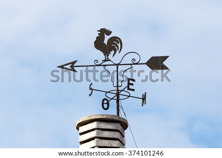 Weathercock on the chimney - stock photo