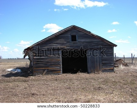 weathered abandoned farm building garage