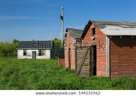 Weathered and abandoned buildings in an old farm yard
