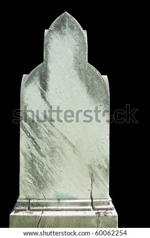 Weathered and cracked nineteenth century gravestone isolated on black - stock photo
