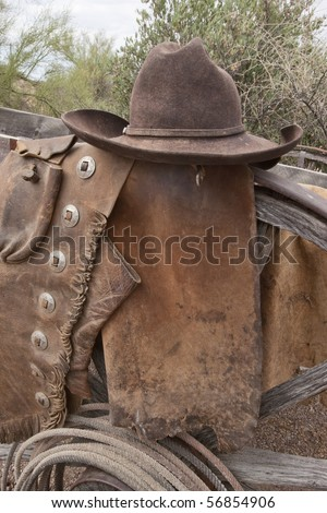 Weathered and well worn old Western Cowboy wear. Grunge intact. - stock photo