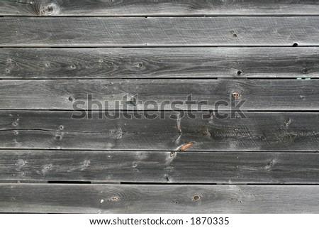 Weathered bard board siding background - stock photo