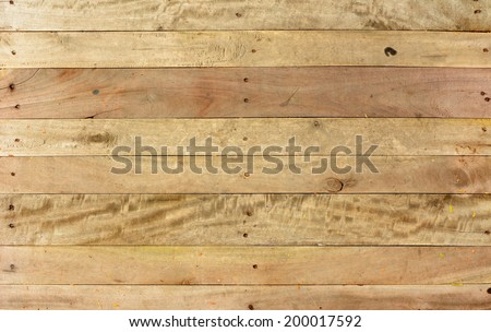 Weathered barn wood background with knots and nail - stock photo