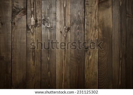 weathered barn wood background with knots and nail holes - stock photo