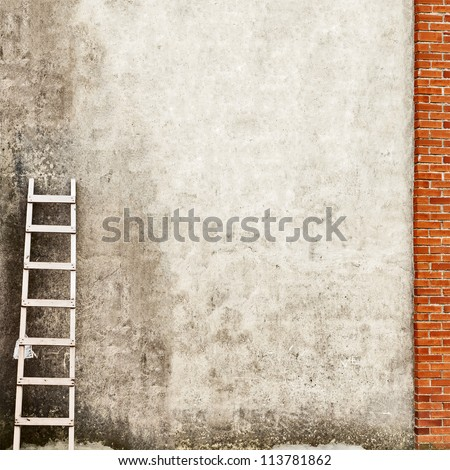 weathered brick wall with wooden ladder background - stock photo