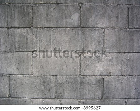 weathered cement brick wall - stock photo