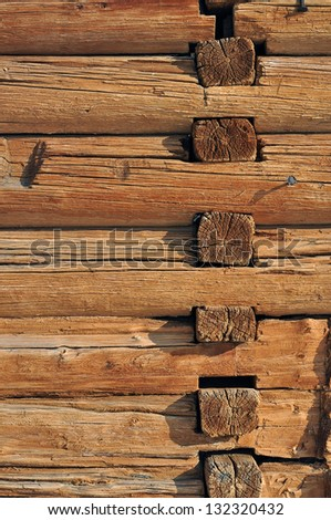 Weathered cracked wooden logs wall of rural house vintage background - stock photo
