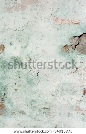 Weathered damaged old painted wall