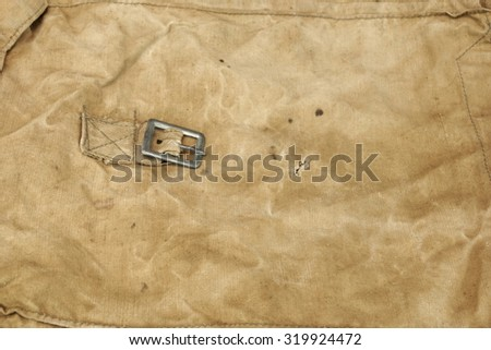Weathered Faded Military Army Style Camouflage Backpack Or Bag Or Uniform Background Texture Closeup