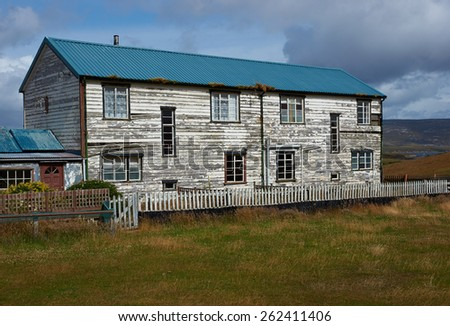 Weathered farm house on the coast at Port San Carlos in the Falkland Islands