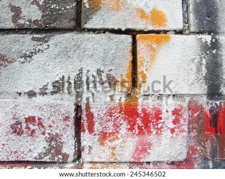 weathered graffiti spray paint brick wall  - stock photo