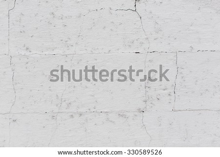 Weathered grungy wall texture with mold spots from damp, cracked off-white paint and discoloration in a full frame background for copyspace - stock photo