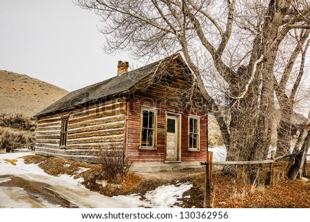 Weathered house in the ghost town of Bannack, Montana at Bannack State Park. - stock photo