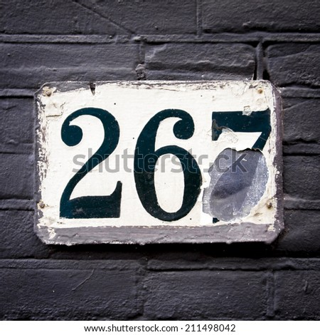weathered house number two hundred and sixty seven - stock photo