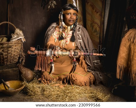 Weathered mature tribal female storyteller talking about heroic times - stock photo