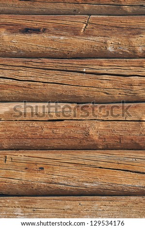 Weathered obsolete cracked wooden logs with natural pattern vintage background - stock photo
