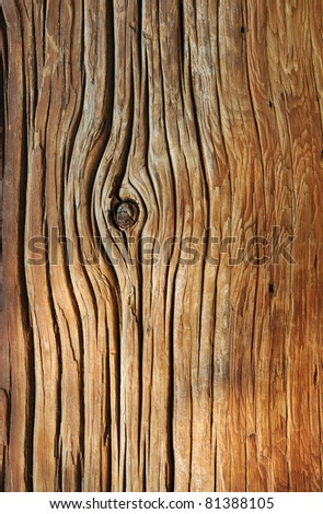 Weathered obsolete rough cracked textured wooden background - stock photo