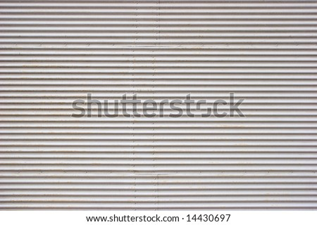 Weathered painted corrugated metal sheet texture background - stock photo