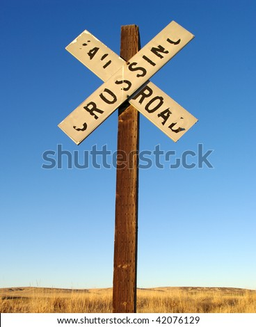 "Weathered ""railroad crossing"" sign on a county road in the Pacific Northwest. - stock photo"