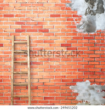 weathered red brick wall with wooden ladder background - stock photo