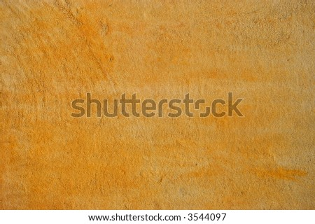 Weathered red sandstone surface texture - stock photo