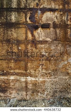weathered stone wall - stock photo