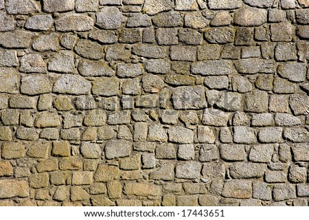 Weathered Stonewall Background from a Castle Wall - stock photo