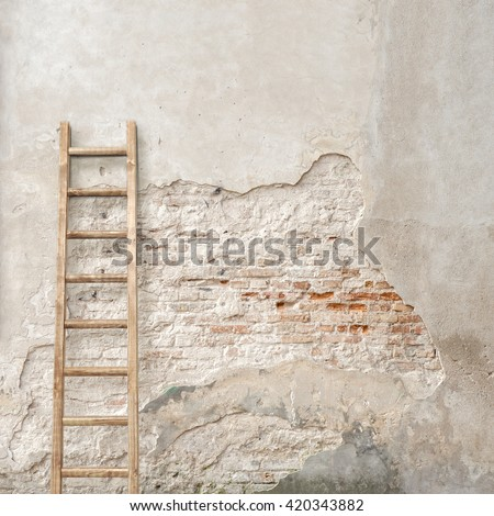 weathered stucco wall with wooden ladder background - stock photo