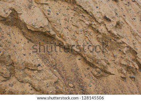 Weathered texture of sand pile surface as background - stock photo