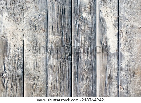 Weathered wood background texture. Old rugged planks with screws for background texture. - stock photo