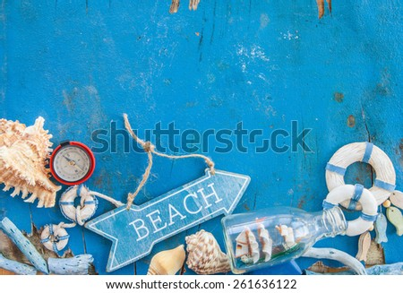 Weathered wooden background with maritime decorations and sea shells - stock photo