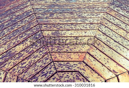 Weathered wooden square with textured grain and X -  shaped or diamond  -  shaped pattern processed in vintage style - stock photo