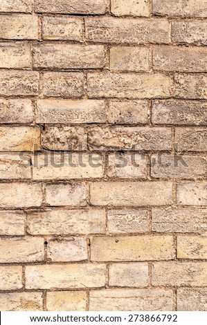 Weathered yellow brick wall vertical view - stock photo