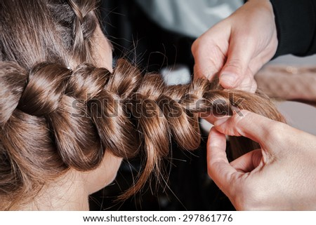 weave braids in a beauty salon - stock photo