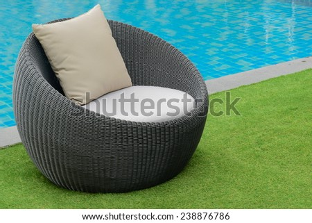 weave chair side pool at hotel - stock photo