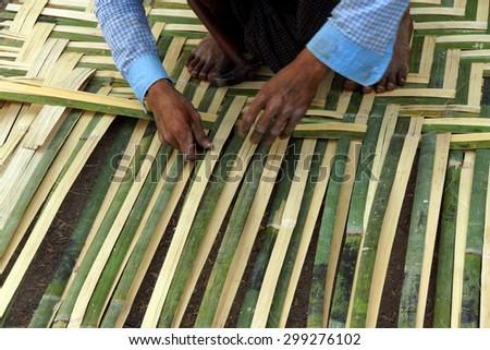 Weaving a bamboo mat,  Hsipaw,  Myanmar (Burma) - stock photo