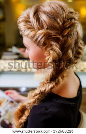 weaving braids for long hair - stock photo