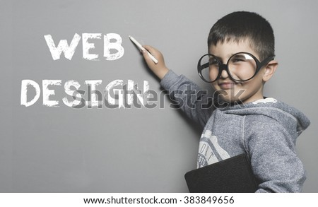 WEB, boy with glasses and funny gesture writing on the blackboard the text Web design