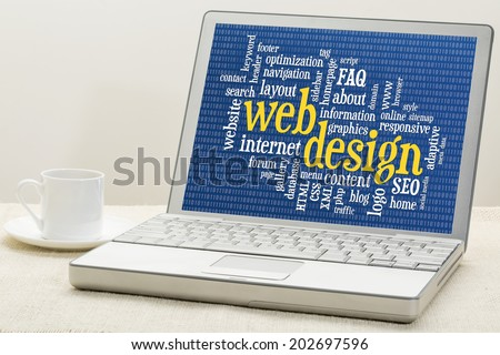 web design and development word cloud with binary background on laptop with a cup of coffee - stock photo