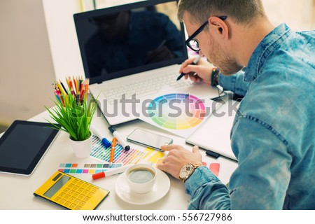 Web designer working on the best framework of a new application