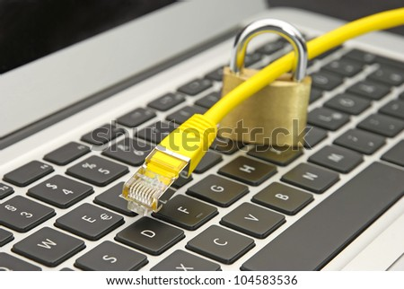 Web security with yellow ethernet cable and secured lock - stock photo